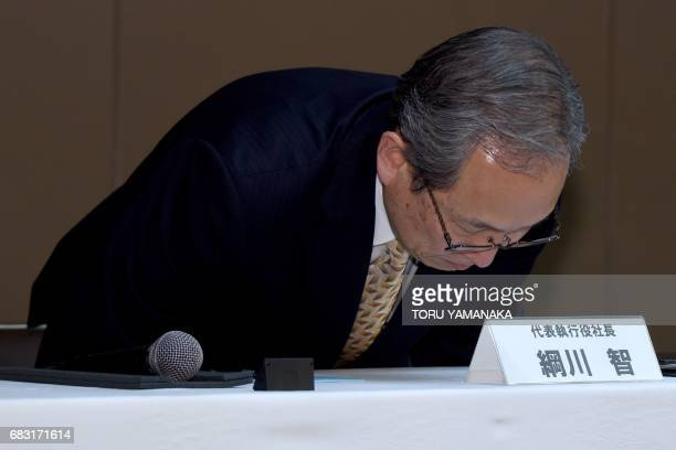 Satoshi Tsunakawa president of Toshiba appears at a press conference at the headquarters in Tokyo on May 15 2017 Troubled conglomerate Toshiba on May...