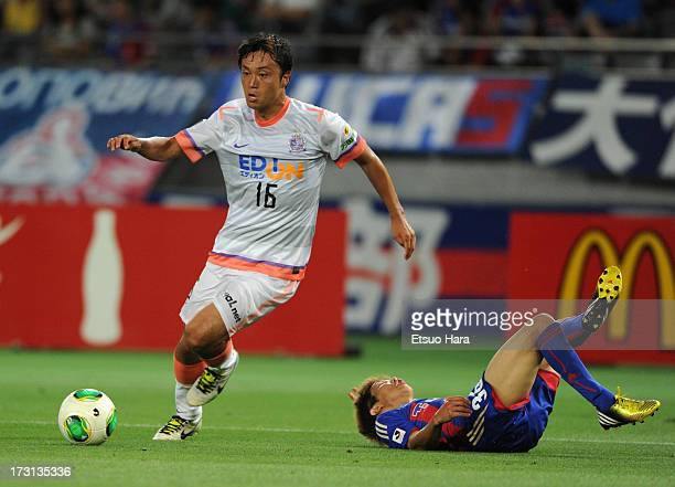 Satoshi Yamagishi of Sanfrecce Hiroshima and Hirotaka Mita of FC Tokyo compete for the ball during the JLeague match between FC Tokyo and Sanfrecce...