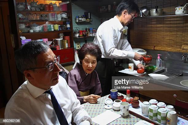 Satoshi Yamashita and Shigera Tanabka have tea with Geisha Yuko Asakusa at her home studio in the Asakusa District on November 6 2014 in Tokyo Japan...