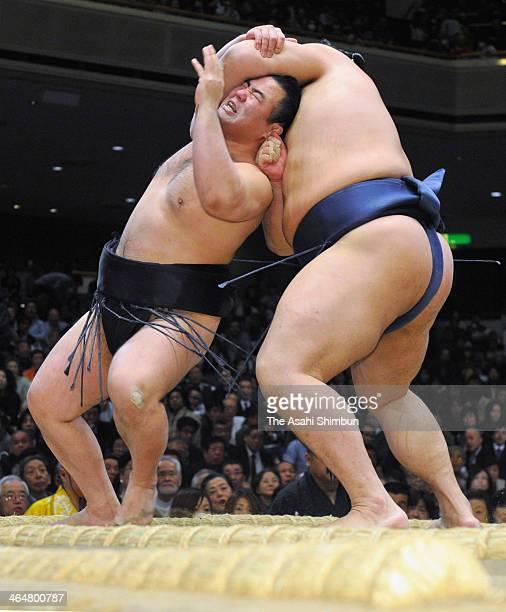 Satoyama throws Tochinowaka during day twelve of the Grand Sumo New Year Tournament at Ryogoku Kokugikan on January 23 2014 in Tokyo Japan