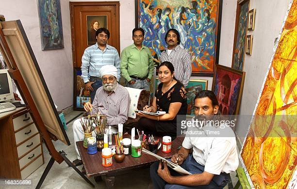 Satpal Singh Surinder Singh Balwinder Kaur Purushatyam Singh and Harwinder Singh members of a painters family on October 28 2010 in Faridabad India
