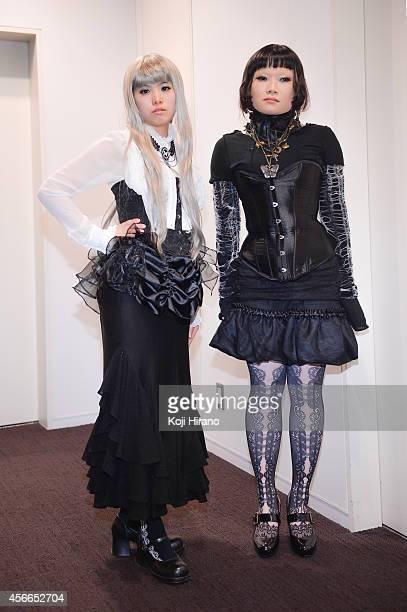 Satsuki and Kana wear a dress by Alice Auaa at MercedesBenz Fashion Week Tokyo Autumn/Winter 2014 at Shibuya Hikarie on March 22 2014 in Tokyo Japan