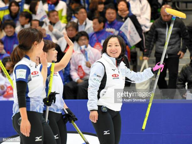 Satsuki Fujisawa and LS Kitami members applaud their supporters after their victory in Game One of the Japan Women's Curling Olympic Qualifier...