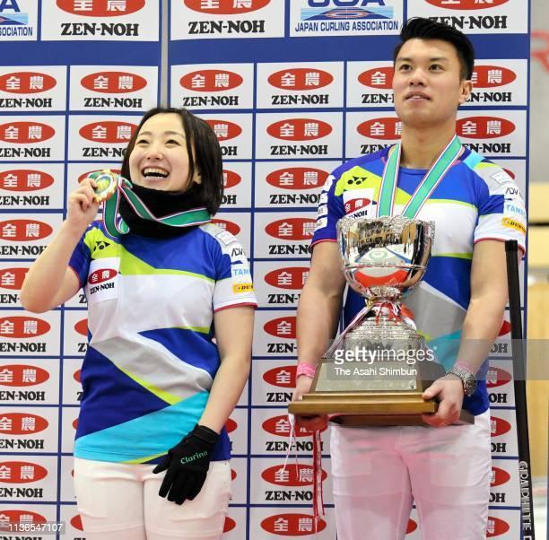 Satsuki Fujisawa and Tsuyoshi Yamaguchi celebrate at the medal ceremony after the 12th Japan Mixed Doubles Curling Championship at Karuizawa Ice Park...