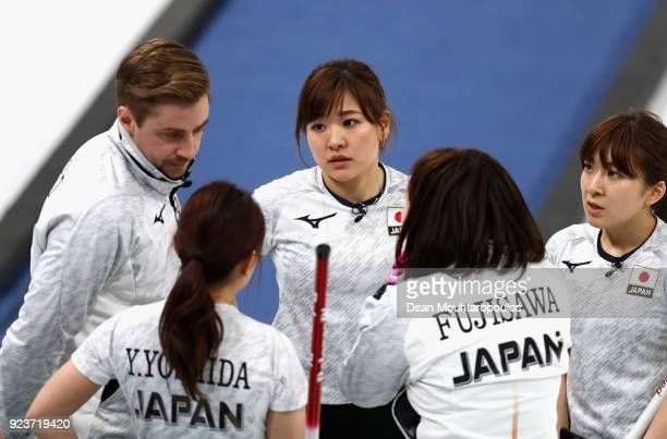 Satsuki Fujisawa, Chinami Yoshida, Yumi Suzuki and Yurika Yoshida of Japan in conversation during the Curling Womens' bronze Medal match between...