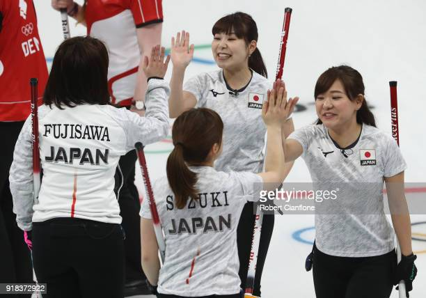 Satsuki Fujisawa Chinami Yoshida Yurika Yishida and Yumi Suzuki of Japan celebrate after winning their match during the Curling Women's Round Robin...