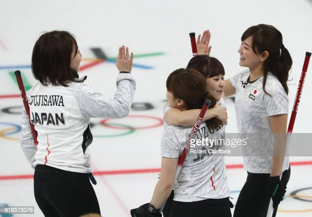 Satsuki Fujisawa Chinami Yoshida Yurika Yishida and Yumi Suzuki of Japan celebrate after winning their match during the Curling Women's Round Robin...