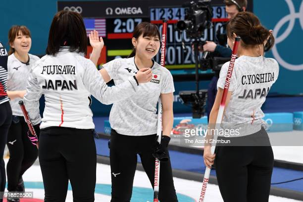 Satsuki Fujisawa Chinami Yoshida Yurika Yoshida and Yumi Suzuki of Japan celebrate after winning the Curling Women's Round Robin Session 3 against...
