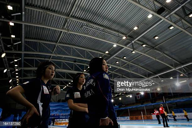 Satsuki Fujisawa, Emi Shimizu and Chiaki Matsumura of Japan look on in the match between Japan and Russia on Day 5 of the Titlis Glacier Mountain...