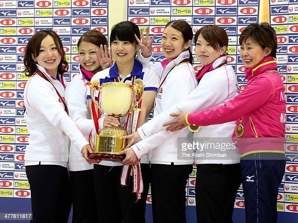 Satsuki Fujisawa Miyo Ichikawa Chiaki Matsumura Emi Shimizu Miyuki Sato and coach Hatomi Nagaoka of Chubu Electric Power Co pose for photographs with...