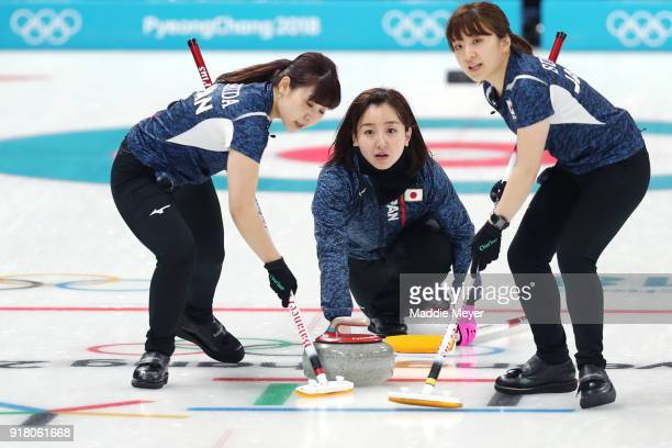 Satsuki Fujisawa of Japan casts a stone between Yumi Suzuki and Chinami Yoshida during Women's Round Robin Session 1 on day five of the PyeongChang...