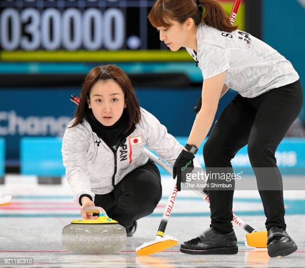 Satsuki Fujisawa of Japan delivers the stone in the 7th end during the Curling Women's Round Robin session 10 against Great Britain on day eleven of...