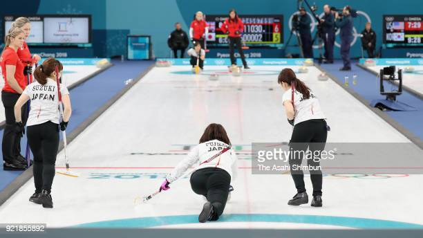 Satsuki Fujisawa of Japan delivers the stone in the 8th end during the Curling Women's Round Robin session 10 against Great Britain on day eleven of...