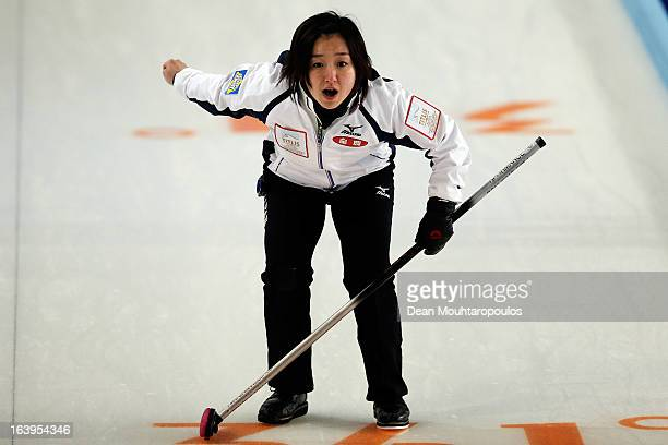 Satsuki Fujisawa of Japan screams instructions after she throws the stone in the match between Japan and Scotland during Day 3 of the Titlis Glacier...