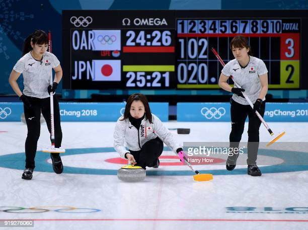 Satsuki Fujisawa of Japan throws as Yurika Yoshida and Yumi Suzuki prepare to sweep in a match against the Olympic Athletes from Russia during the...