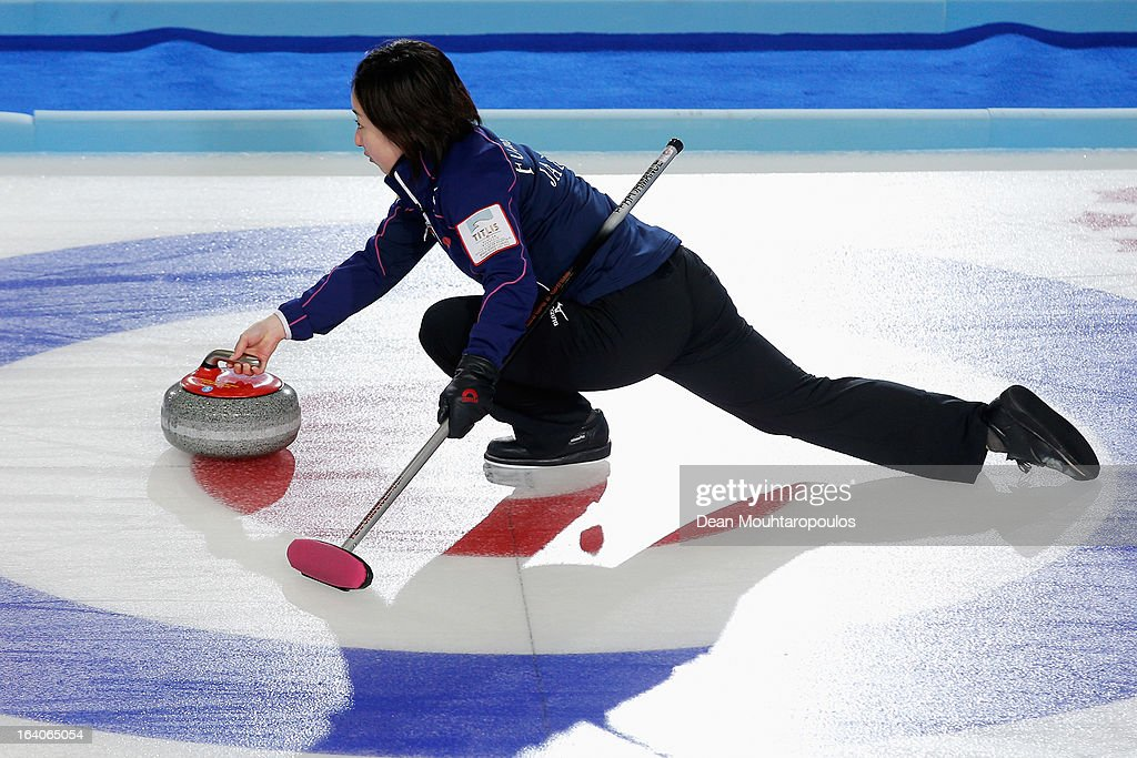 Satsuki Fujisawa of Japan throws the stone in the match between Japan and USA on Day 4 of the Titlis Glacier Mountain World Women's Curling Championship at the Volvo Sports Centre on March 19, 2013 in Riga, Latvia.