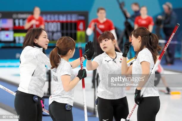 Satsuki Fujisawa Yumi Suzuki Yurika Yoshida and Chinami Yoshida of Japan celebrate in the 7th end during the Curling Women's Round Robin session 10...