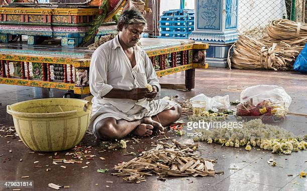 sattharar making a floral garment in a hindu temple. - chennai stock pictures, royalty-free photos & images