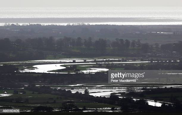 Saturated ground and flood water surrounds the river Arun as it aproaches the sea on February 2 2014 near Arundel England Flood warnings have been...