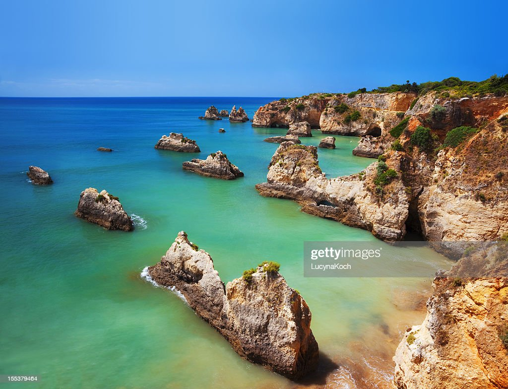 Saturated image of a colorful Algarve beach in Portugal : Stock Photo