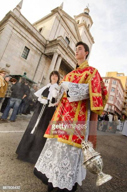 Saturday 23 March 2013 Santander Spain The first procession of Holy Week 2013 makes its way across the city centre Two young altar boys walk with an...