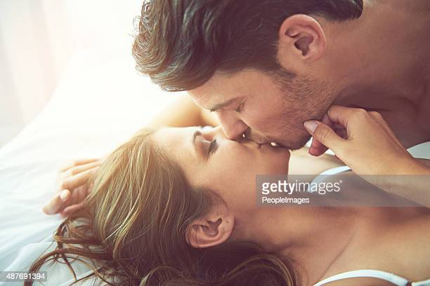saturday morning seduction - kissing stock pictures, royalty-free photos & images