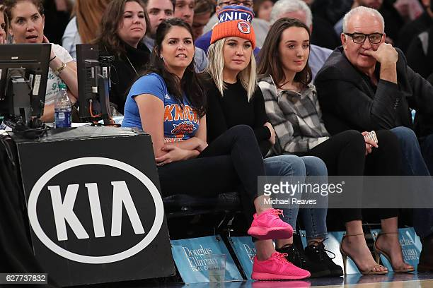 Saturday Night Liv cast member Cecily Strong and former professional boxer Gerry Cooney watch the game between the Sacramento Kings and the New York...
