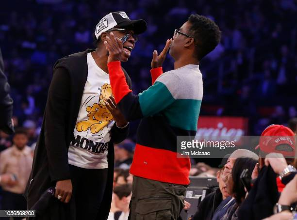 'Saturday Night Live' cast member Leslie Jones and comedian Chris Rock attend a game between the New York Knicks and the Golden State Warriors at...