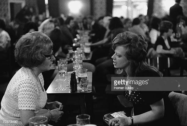 Saturday night out at Byker St Peters Working Men's Social Club in Newcastle Upon Tyne 1973 Two women chat across a table