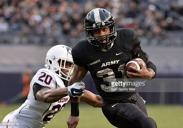 Army Black Knights running back Terry Baggett runs past the reach of UConn Huskies safety Obi Melifonwu during the 1st half of a NCAA football game...