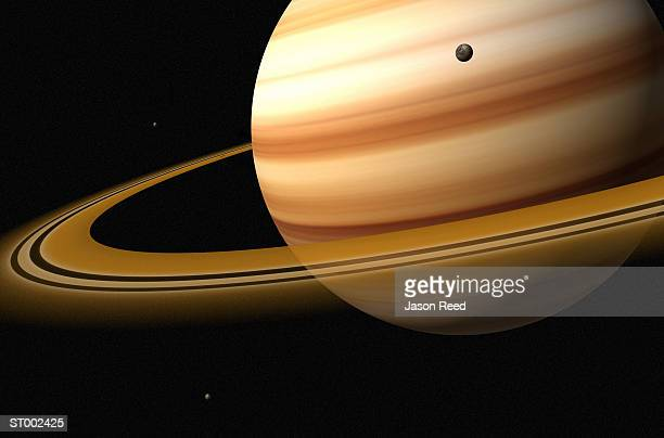 Saturn and a Moon of Saturn