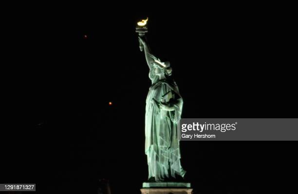 Saturn and Jupiter set behind the Statue of Liberty ahead of their conjunction next week on December 17, 2020 in New York City.