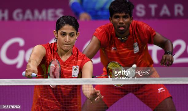 Satwik Rankireddy and teammate Ashwini Ponnappa of India play a return to their opponents Yong Hee and Jia Woing of Singapore during their mixed team...