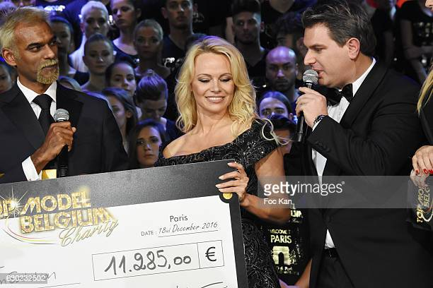 Satya Oblette and Jeremy Urbain offered a check to Pamela Anderson association during the 'Top Model Belgium 2017' Ceremony at Le Lido on December 18...