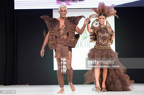 Satya Oblette and Ludivine Sagna walk the runway during the 'Salon Du Chocolat' Fashion Show on October 29 2014 in Paris France