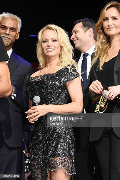 Satya Oblette Pamela Anderson and Adriana Karembeu attend the 'Top Model Belgium 2017' Ceremony at Le Lido on December 18 2016 in Paris France