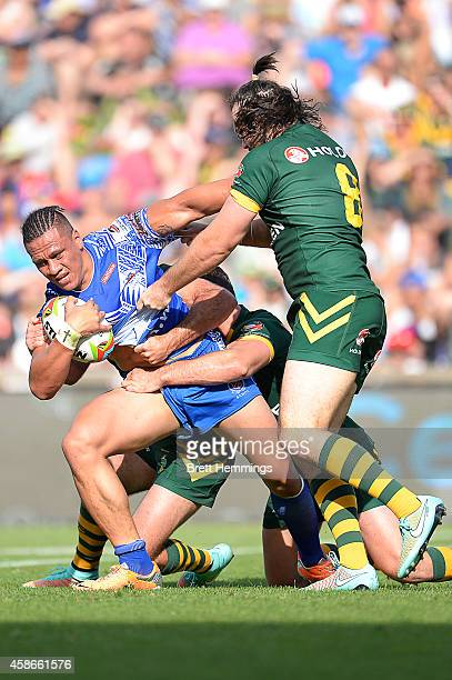 Sauaso Sue of Samoa is tackled during the Four Nations match between the Australian Kangaroos and Samoa at WIN Stadium on November 9 2014 in...