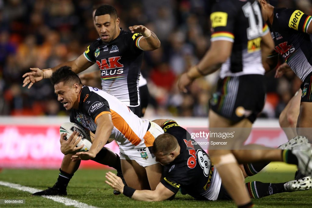 Sauaso Sue of the Tigers is tackled during the round 11 NRL match between the Penrith Panthers and the Wests Tigers at Panthers Stadium on May 17, 2018 in Penrith, Australia.