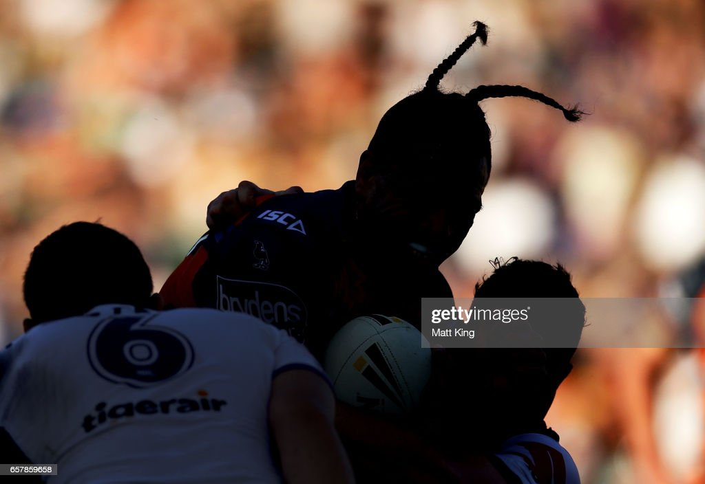 Sauaso Sue of the Tigers is tackled during the round four NRL match between the Wests Tigers and the Melbourne Storm at Leichhardt Oval on March 26, 2017 in Sydney, Australia.