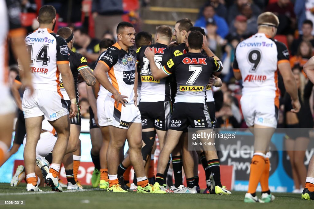 Sauaso Sue of the Tigers looks dejected after a Panthers try during the round 22 NRL match between the Penrith Panthers and the Wests Tigers at Pepper Stadium on August 6, 2017 in Sydney, Australia.