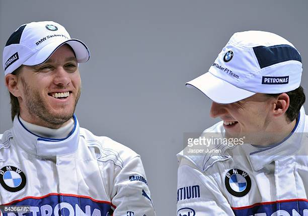 Sauber drivers Nick Heidfeld of Germany and Robert Kubica of Poland smile as they speak to the media after unveiling the new BMW Sauber F1.09 formula...