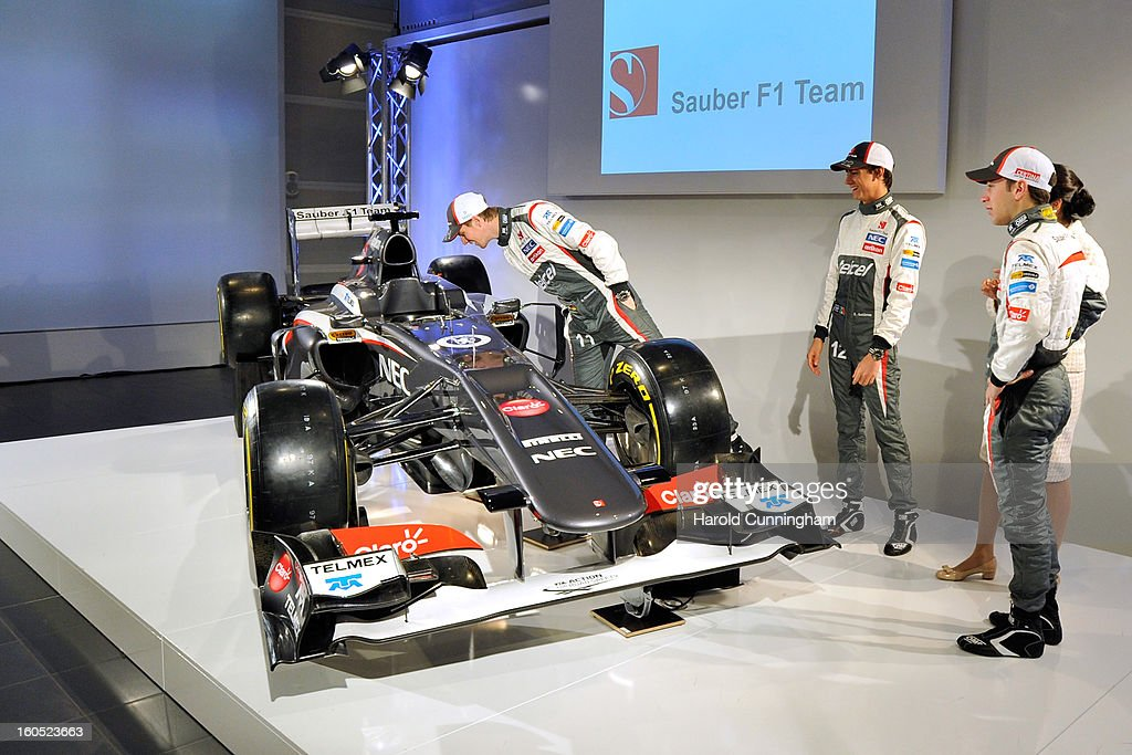 Sauber F1 driver Nico Hulkenberg of Germany checks a detail of his new Sauber C32-Ferrari F1 as Sauber F1 driver Esteban Gutierrez of Mexico, Team Principal Monisha Kaltenborn, and Sauber Formula 1 reserve driver Robin Frijns of the Netherlands look on as they unveil the Sauber C32-Ferrari new car for the 2013 Formula 1 season during the launch at the Sauber Motorsport AG on February 2, 2013 in Hinwil, Switzerland.