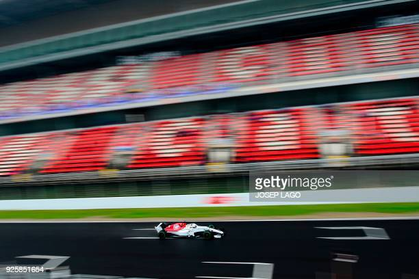Sauber F1 Team's Swedish driver Marcus Ericsson drives at the Circuit de Catalunya on March 1 2018 in Montmelo on the outskirts of Barcelona during...