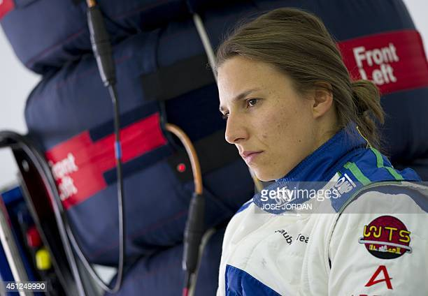 Sauber F1 Team's Swiss Formula One driver Simona de Silvestro speaks with mechanics during private test at the Ricardo Tormo racetrack in Valencia on...