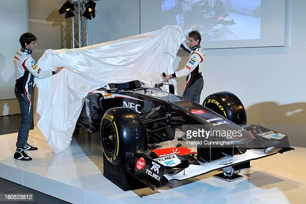 Sauber Formula 1 drivers Esteban Gutierrez of Mexico and Nico Hulkenberg of Germany unveil the Sauber C32Ferrari new car for the 2013 Formula 1...