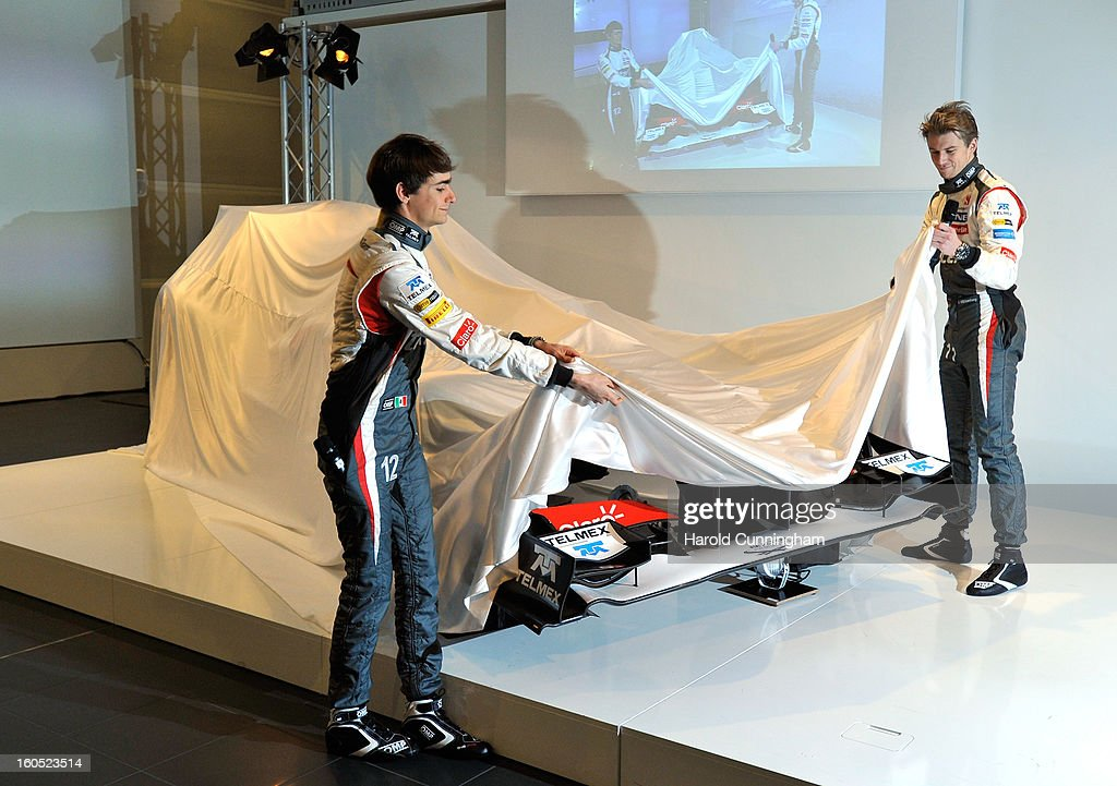 Sauber Formula 1 drivers Esteban Gutierrez of Mexico and Nico Hulkenberg of Germany unveil the Sauber C32-Ferrari new car for the 2013 Formula 1 season, during the launch at the Sauber Motorsport AG on February 2, 2013 in Hinwil, Switzerland.