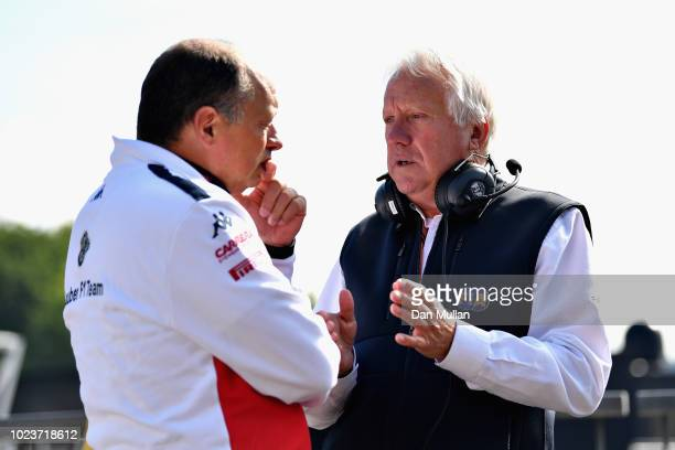 Sauber Team Principal Frederic Vasseur and FIA Race Director Charlie Whiting talk in the Paddock before the Formula One Grand Prix of Belgium at...