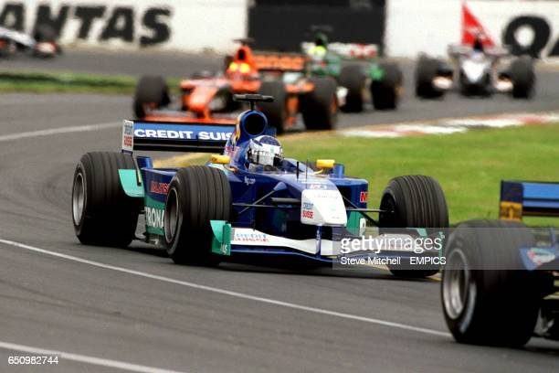 Sauber's Kimi Raikkonen corners on his way to a superb seventh place on his debut which was later improved to sixth after Olivier Panis suffered a 25...