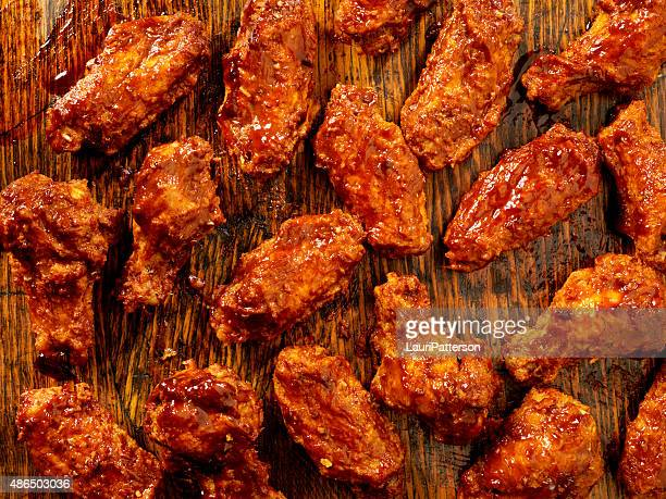 bbq sauce chicken wings - chicken wings stock pictures, royalty-free photos & images