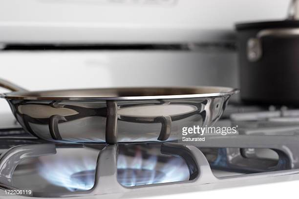 Saucepan Cooking over Blue Natural Gas Flame